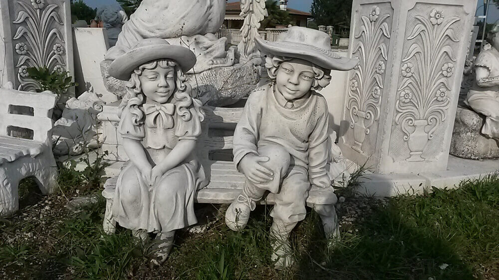 GIARDINO Statue Coppia bimbi su panca PU3125